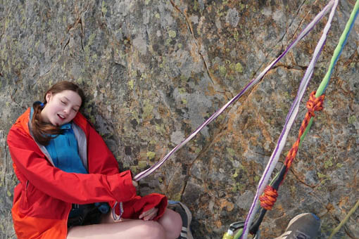 A small image of two people abseiling together