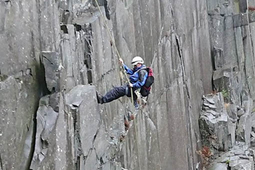 A small image of a person abseiling