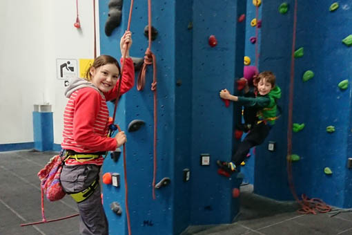 A small image of two children climbing