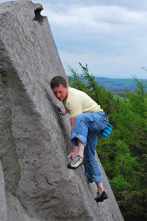 Climber scaling a rock face